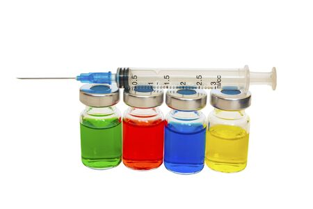 The syringe lies on the vessels with colored liquid