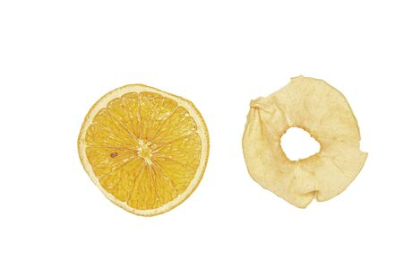 Dried slices of orange and apple for mulled wine on a white background. Isolate.