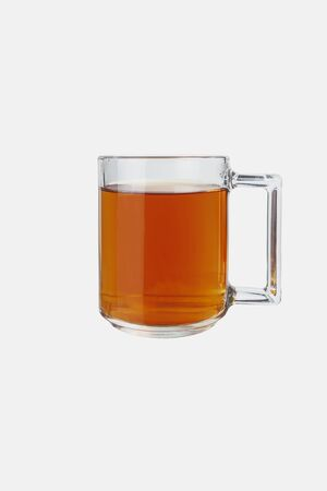 Glass mug with tea on a white background. Isolate