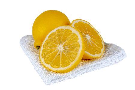 Lemons lie on a towel, all on a white background Reklamní fotografie