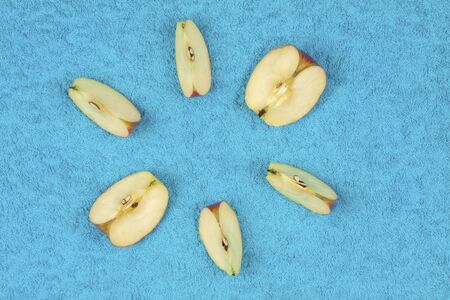 Sliced apples lie on a colored background, photo from above