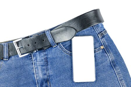 Theres a phone on the jeans. A phone with a white background to insert a picture or text.