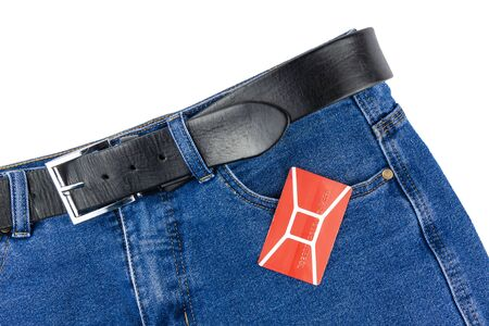 On the pants lies a discount card. Foto de archivo