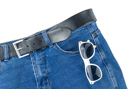 Trousers with sun-covered glasses lie on a white background. Foto de archivo
