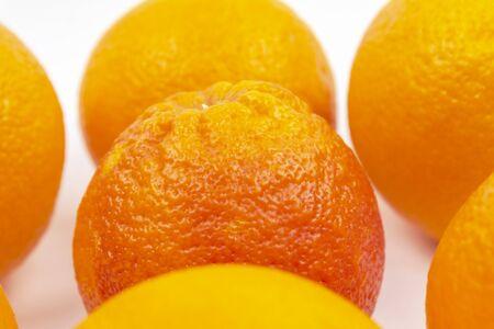 Red orange slices yellow oranges. Close-up