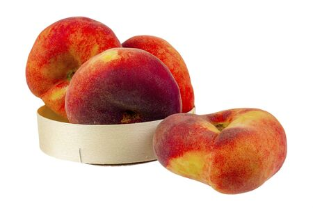Flat peaches in a package on a white background