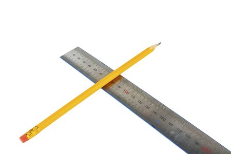 Wooden pencil and metal ruler on a white background