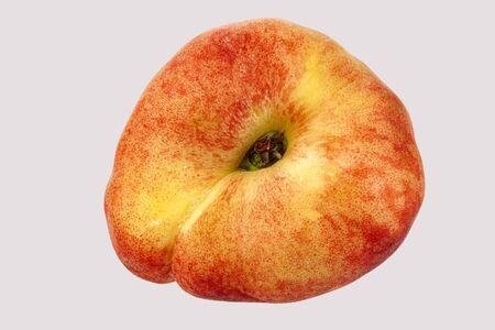 Flat peach close-up on a white background. Foto de archivo