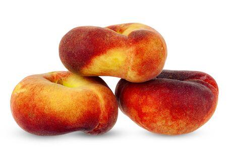 Flat peaches, close-up on a white background. Foto de archivo