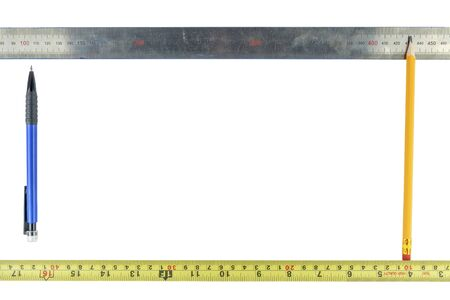 Frame of pencils and rulers on a white background. Foto de archivo
