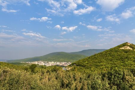 Background, old mountains, gorge city, blue sky. Foto de archivo