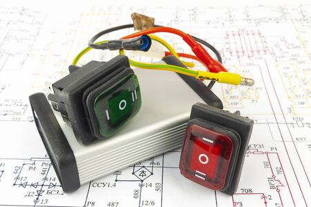 The electronic block and switches lie on a paper electronic circuit