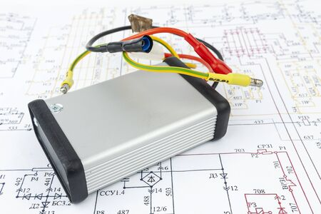 The electrical unit lies on a paper electrical circuit