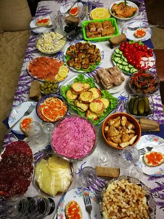 Festive table with different dishes in Russia. Close-up Foto de archivo