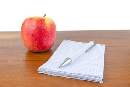 An apple notepad and a lie on the table
