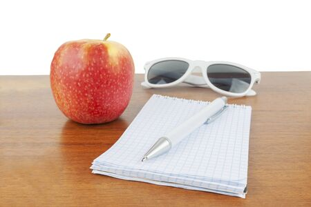 Apple glasses handle notepad lie on the table