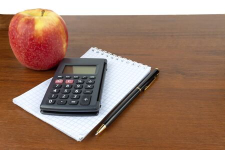 Apple notepad calculator pen lie on the table