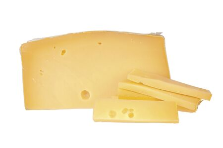A large piece of cheese with sliced slices on a white Foto de archivo