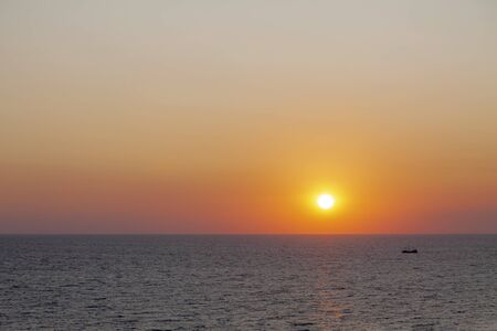 Evening sun in the sea with no cloudy skies