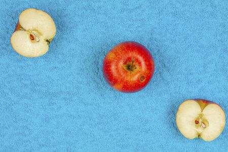 Apple and half of the apple lie on a colored background Imagens