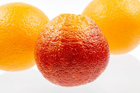 Red tangerine on a white background close-up