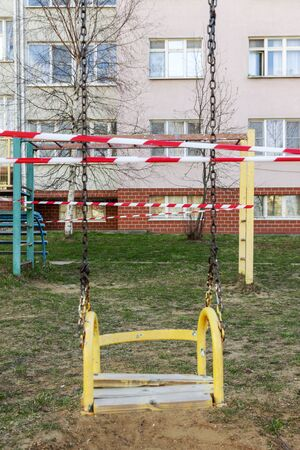 Self-isolation, a ban on walking. Children's swings are closed, you can't ride Foto de archivo - 147801935