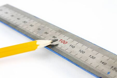 Pencil and ruler lie on a white background