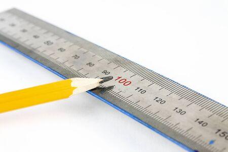Pencil and ruler lie on a white background Foto de archivo - 147757341