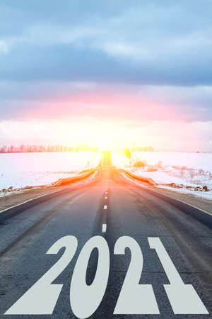 New year theme. The year 2021 is written on the road. All the good is ahead.