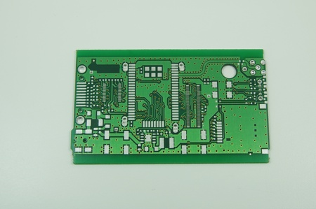 green printed circuit board pcb without any components saldered on it photo