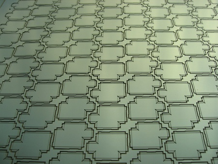 damping: a panel of etched metal rf shields screens for electronics