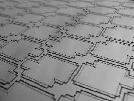 etch: a panel of etched metal rf shields screens for electronics