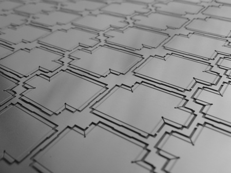 a panel of etched metal rf shields screens for electronics photo