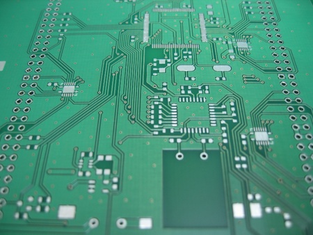 soldered: green printec circuit board PCB without any components soldered