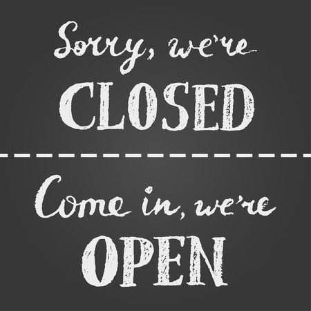 store window: Open and closed chalk sign. White letters on gray gradient background. Full inscription is sorry we are closed and come in we are open.