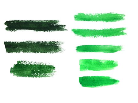 tints: Colorful watercolor brush strokes. Dark and light green tints. Isolated spots on white background. Stock Photo