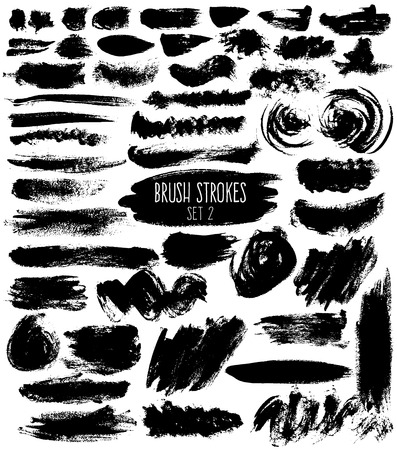 calligraphical: Brush hatches set. Black painted elements of unusual shapes on white background. Expressive isolated brush strokes.