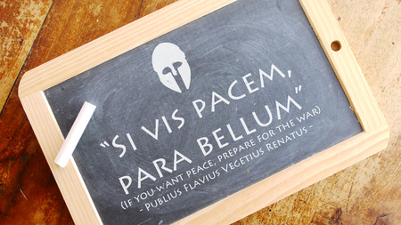 meaning: Si vis pacem, para bellum. Latin phrase meaning If you want peace, prepare for the war. Stock Photo