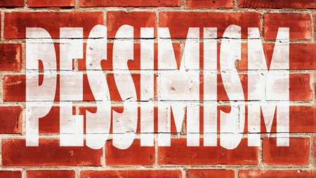 pessimism: Pessimism written On A Brick Wall. Stock Photo