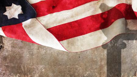 pensador: sombra pensador en concreto. Bandera de EE.UU. Foto de archivo