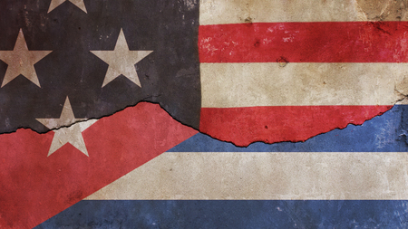 US Flag and Cuba Flag on Cracked Concrete Wall