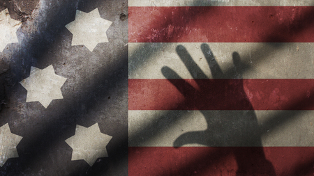 US Flag with Gate and Shadow Hand Banco de Imagens