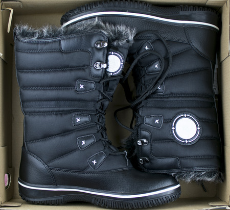 winter boots with high bootleg with lacing in the shoebox