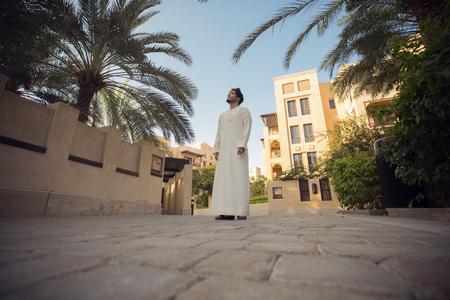 Arab man walking in a traditional area in Dubai