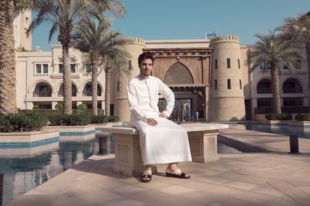 Arab man sit Stock Photo