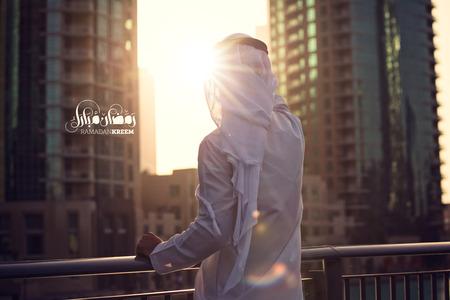 Arabic man waiting for Ramadan in Dubai ( Ramadan Kreem Arabic text )