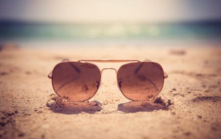 Summer time sunglasses on the sand of jumeira beach, Dubai UAE