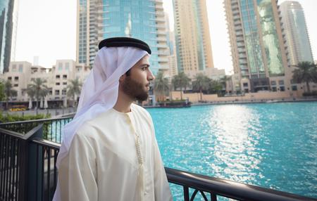 Arab young man looking to Dubai skyline Foto de archivo