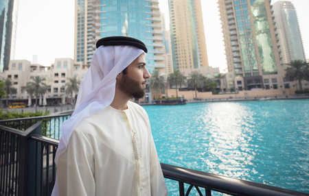 Arab young man looking to Dubai skyline Stock Photo