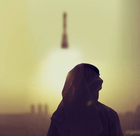 Arab man in the lunch base watching the UAE space rocket flying to the new future